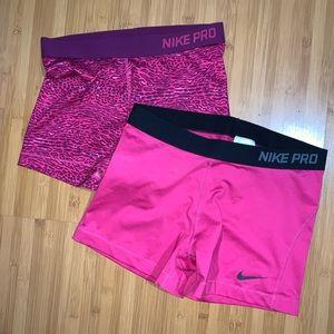 2 Pink Nike Pros
